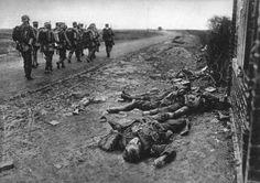 German soldiers walk past fallen British soldiers, following heavy street fighting in the village of Moreuil, circa 1918 via reddit