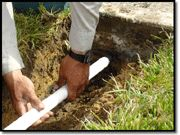This article explains how to dig and run pipe under an obstacle such as a driveway or sidewalk. The most efficient and cost effective way to bore under an obstacle is to create a hole using the power of water.