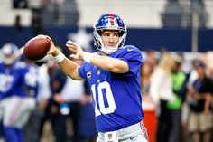 New York Giants vs. Dallas Cowboys:   New York Giants quarterback Eli Manning (10) prepares to throw a pass as he warms up before an NFL football game against the Dallas Cowboys on Sunday Sept. 11, 2016, in Arlington, Texas. (Ron Jenkins | The Associated Press)