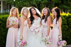 Seattle wedding bride with bridesmaids by Portland wedding photographer Dina Chmut