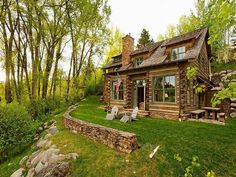 I like the green with the brown, the rock foundation and the adirondacks in the front yard