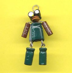 Artomat Artist ObviousFront makes these Robot Sculptures from salvaged electronics. Earth Tone Robot Necklace. $10.00, via Etsy.