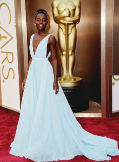 Is it us or does Lupita Nyong'o look like a princess in this #Prada gown? #Oscars