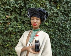Available for sale from Christopher Moller Gallery, Tony Gum, Black Coca-Cola Series - Xhosa woman C-type print on fuji crystal archive paper Ed M/… Xhosa, South African Art, Contemporary African Art, Famous Black, Art Fair, Coca Cola, Cool Girl, Winter Hats, Artsy