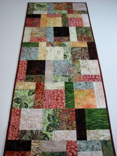 Quilted Table Runner , Autumn Batik Patchwork by VillageQuilts on Etsy