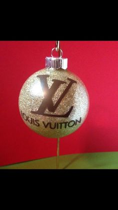 Louis Vuitton Christmas ornament I made #glitter #vinyl Pinterest.com/shersher12