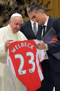 Admiring Welbeck's new kit after his recent transfer to Arsenal.  Danny Welbeck's transfer that is, not Pope Francis. The Pope is still numero uno for The Vatican.