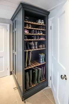 Mudroom storage with boot trays that slide in and out to clean drips
