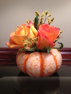 Autumn Flower Arrangement - just hollow out a mini pumpkin, insert a plastic cup full of floral foam and arrange the flowers so that they conceal the opening.