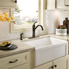 A modern twist on a classic design, the Moen® Braemore Single-Handle Kitchen Faucet is a great addition to any home. With soft curves, a matching side sprayer and vintage look, this faucet will enhance your home in no time!