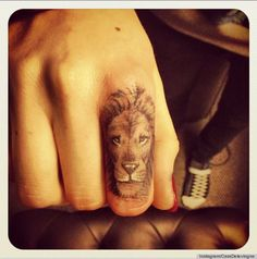cara delevingne. That has got to be the most beautiful finger tattoo I have ever seen. So much detail on such a small surface