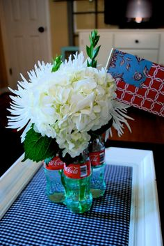 FLOWER CENTERPIECE WITH COCA COLA BOTTLES