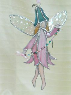 Stained glass pink fairy sun catcher.Garden fairy by ClearerImage, $29.95