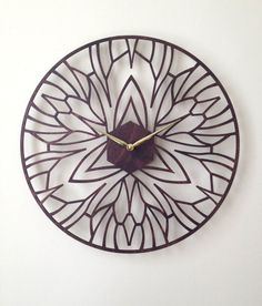 Iris Clock. Modern Laser Cut Wood Wall Clock.