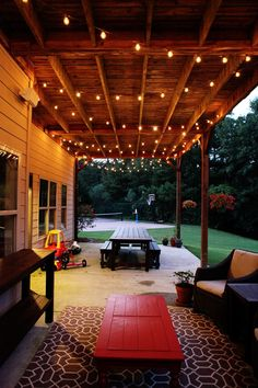 lights hung under deck area- great for lighting on summer nights!
