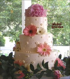 Classic white wedding cake with gerber daisies by Wicked Goodies