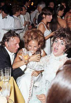 Richard Burton, Claudia Cardinale, and Elizabeth Taylor toast at the 28th Venice Film Festival, 1967.