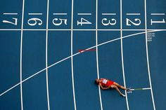 Halima Hachlaf of Morocco lies on the track after competing in the women's 800-meter semifinals IAAF World Athletics Championships in Moscow on Aug. 16.