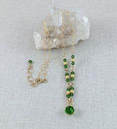 Faceted Dark Green Quartz Pendant Necklace with Green Swarovski Crystals, Gold Stardust Beads on Gold Filled Chain $75 USD #greenquartz #greenandgold #goldandgreen #gemstonenecklace #dressynecklace #facetedgreenquartz