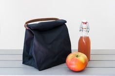 Nothing beats a homemade lunch or snack, and now you can carry it in style in this stream-lined bag that's water-resistant and flat on the bottom to keep food upright. The bag totes easily by the sturdy leather handle. This roomy bag will fit not only sandwiches but even stacked containers, snack bags, and a cookie or two. And the stylish waxed cotton will keep you and your lunch protected from small leaks and raindrops. Now improved to be even more durable and sturdier. The lunch bag…