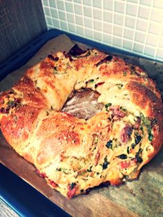 Homemade bread - stuffed with herbs, cheese, proscuitto and dried tomatoes