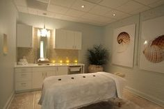 Coastal-inspired massage room at OCCO Skin Studio in Columbia, S.C. Full-scale commercial interior design project by MACK Home.