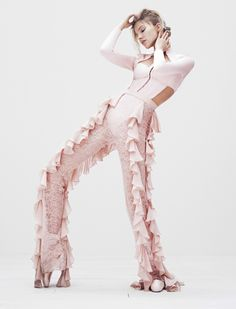 Looking pretty in pink, Sasha Luss models Balmain top and ruffle-decorated pants for Vogue Magazine Japan December 2016 issue