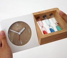 Cool! An alarm clock with three hourglasses to let you sleep just the last few minutes in the morning.