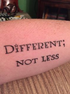 tattoo reads: different, not less