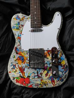 Spiderman tele style electric guitar with mix of by ComicDecor, £100.00