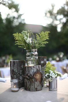 rustic and simple centerpiece - logs and mason jars