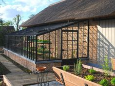 Wrought iron conservatory which is custom-made and installed on-site, the perfect glass greenhouse for vegetables and grapes. This lean-to conservatory is built against an existing façade of the client. Contact us for more information or request a quote right away! Dimensions wrought iron conservatory L x W x H: 8,54 x 3 x 2,65 metres Built on a wall of #conservatorygreenhouse