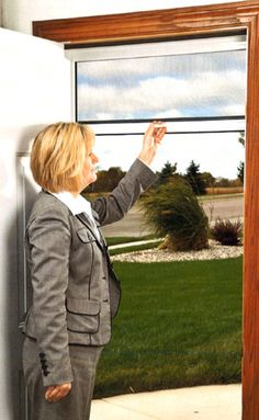 LARSON Comfort Breeze retractable screen doors disappears when not in use and protects against airborne pests. Click for more information. #LARSONdoors #StormDoors