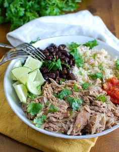 Slow Cooker Cuban Pork Rice Bowls make a healthy lunch or dinner that are easily customizable to your tastes. These bowls are a great on-the-go option.