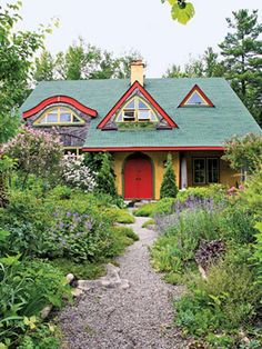 A straw bale home - so cute and colorful!