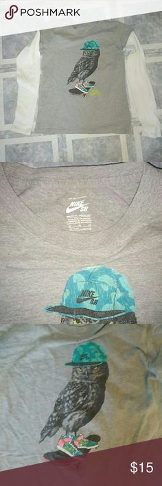 Nike Skateboarding Youth XL sz Owl T-SHIRT (long) Nike SB Youth 13-15 y/o XL sized ~ Long white sleeves on Heather Grey T-shirt w/ screen printed skateboarding Owl wearing Nike shoes.  Freshly laundered now but sleeves are slightly stained by the hands area because this was a teenage boys shirt and white sleeves but I can go ahead and try some heavy duty bleach or just leave it as is whichever way you want. I have never really noticed til just now when going through old thing's trying to…