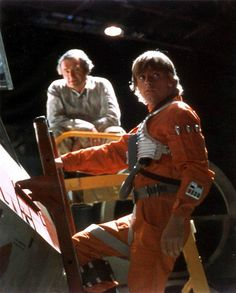 Mark Hamill climbing up his X-Wing prop on the Yavin hangar set.