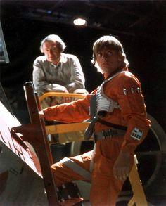 Mark Hamill climbing up his X-Wing prop on the Yavin hangar set.