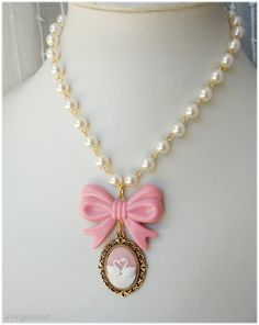 Swan Cameo Necklace, Beaded Pearl Chain with Pastel Pink Bow in Gold - Sweet Lolita, Gyaru. $23.00, via Etsy.