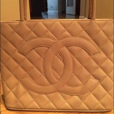 Chanel Quilted Caviar Leather Medallion Tote Bag There are marks on the leather in front that you can see in picture and wear on the bottom corners with one side having a little tear. A few marks on the back. The inside has marks on the leather. This bag has been used but I think it looks amazing. I am happy to provide more pictures for serious buyers. I am selling for a client and she does not have the dust bag and I am not sure what she paid originally. Open to offers but not low ones…