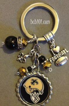 New Orleans Saints inspired bottle cap key chain, NFL, football, sports, bling, black and gold, team spirit,  girly, gift, fantasy football. $16.00, via Etsy.