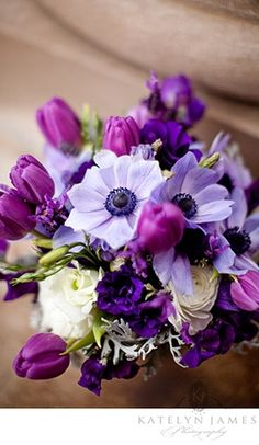 purple tulip and anemone reception wedding flowers,  wedding decor, wedding flower centerpiece, wedding flower arrangement, add pic source on comment and we will update it. www.myfloweraffair.com can create this beautiful wedding flower look.
