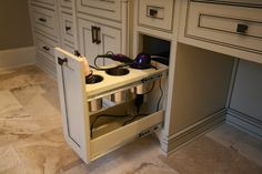 Electrical outlet inside of drawer with cutout for cords.  Metal containers to hold appliances that are still hot.