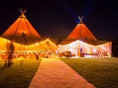 Giant Hat Tipis at night
