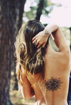 I want a tattoo in the middle of my back!