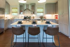 eclectic kitchen with leather barstools, large island, grey cabinets and sheer bamboo shades on windows Eclectic Kitchen, Modern Farmhouse Kitchens, Kitchen Decor, Woven Wood Shades, Bamboo Shades, Small Sectional Sofa, Stainless Kitchen, Faux Wood Blinds, Kitchen Window Treatments