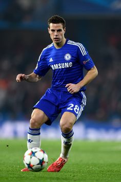 Cesar Azpilicueta of Chelsea runs with the ball during the UEFA Champions League round of 16 second leg match between Chelsea and Paris Saint-Germain at Stamford Bridge on March 11, 2015 in London, England.