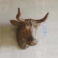 The Golden Bull Head is a quirky piece of wall décor for a rustic or bohemian home. Constructed of rock-hard resin with an antiqued gold patina, this piece is sure to spark plenty of conversations, and...  Find the Golden Bull Head, as seen in the Austin Eclectic Collection at http://dotandbo.com/collections/austin-eclectic?utm_source=pinterest&utm_medium=organic&db_sku=95259
