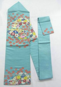 This is an elegant Nagoya obi with colorful flower fan design, which is woven.  Seasonal flower pattern such as 'Botan'(peony), 'Kiku'(chrysanthemum) and kaede (maple leaf) are vibrantly added