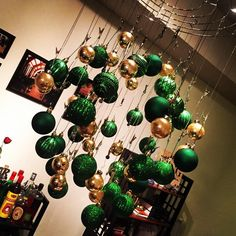 Dangling green and gold ornaments // Now THIS says #BaylorChrismtas!